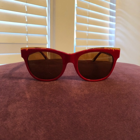 bfbcb7fa4f26 Tory Burch Red Sunglasses with Gold Accent. M_5a80bcd7739d4879751e2054